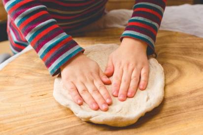 Preparing pizza dough