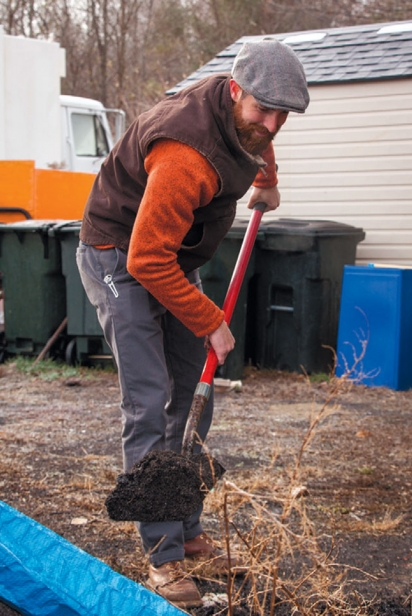 Rian Bedard shoveling